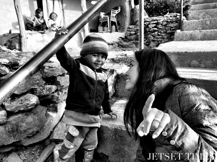 Playing with the cutest child during my hike (Nepal)