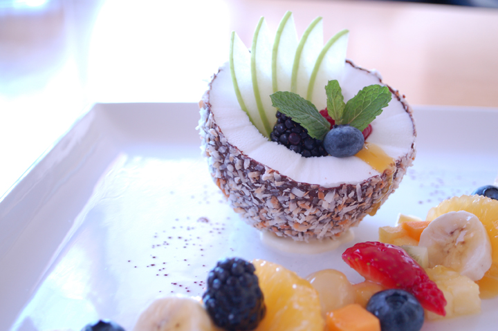 The Coconut, haupia sorbet in a chocolate shell, tropical fruits and passion fruit sauce