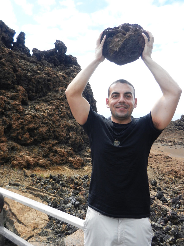 Lifting a not-so heavy rock on Isl a Bartolomè in Galapagos Islands.