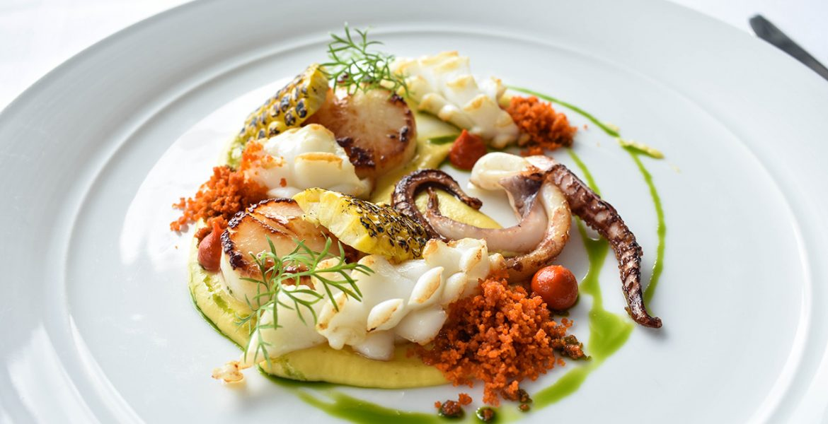 Cover pan seared scallops, squid, chargrilled corn.