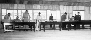 Delegates sign the Korean Armistice Agreement in P'anmunjŏm.