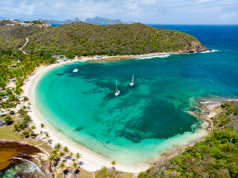 Aerial drone view of tropical island of Mayreau and turquoise