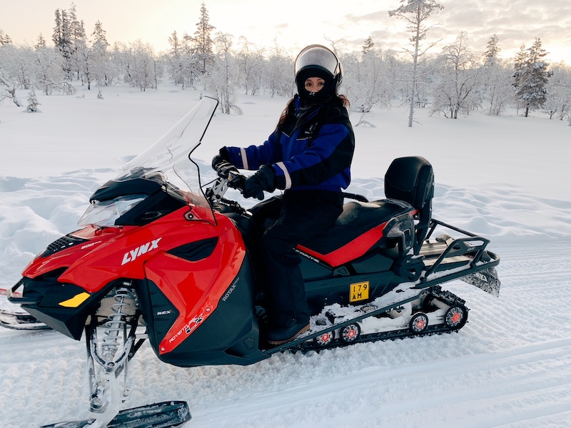 Snowmobiling in Lapland.
